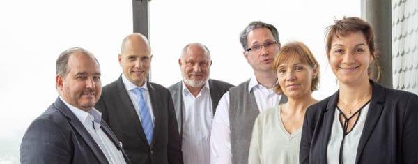 Walter Feil und Carina von Oosten mit den Referenten der Seminare auf der Burg 2019